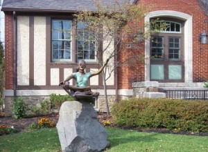 """girl reading"" statue"